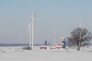 wind turbines towering over farm